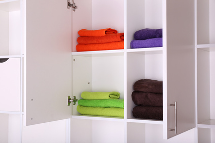White shelves with colored towels close up