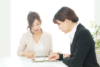 Beautiful young businesswomen working in the office