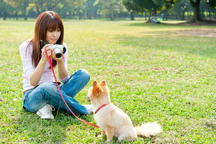 attractive asian woman with dog in the park